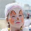 Little beautiful girl with face painting of orange fox at sunny — Stock Photo #49874673
