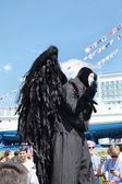 PERM, RUSSIA - JUN 15, 2013: Black angel on stilts. Million peop — Stock Photo