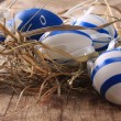 Stock Photo: Easter colored eggs on woden background