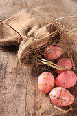 Easter colored eggs on woden background — Stock Photo