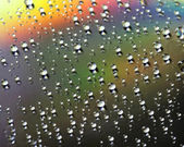 Water drops on colorful surface — Stock Photo