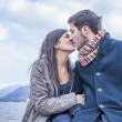 Young couple kissing outdoors — Stock Photo