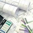 Stock Photo: Project drawings and money