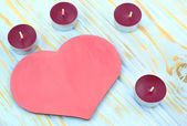 Heart and candles on blue background — Stock Photo