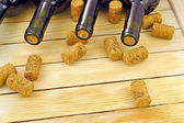 Wine bottles on background wooden slats — Stock Photo