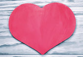 Pink heart on the background tinted wooden planks — Stock Photo