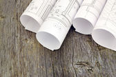 Project drawings on the background of wooden boards — Stock Photo