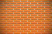 Orange brick wall — Stok fotoğraf
