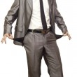 Young businessman showing empty pockets — Stock Photo