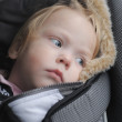 The 14-month-old child wearing seat in the children's car seat — Stock Photo
