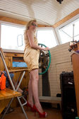 The blonde girl at the helm river ship, looking straight at the viewer — Stock Photo
