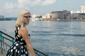 Beautiful blonde with glasses on the banks of the Khimki reservoir, the Moscow — Stock Photo
