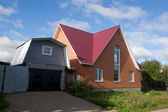 New brick house with garage — Stockfoto