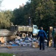 Постер, плакат: The garbage disposal at the dump