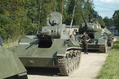 Soviet historical tanks T-70 and T-34 on the ground in the Museum of armored vehicles, Kubinka — Stock Photo