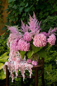 Still life bouquet with pink hydrangea and astilba on the old chair with homemade crochet tablecloth — Stok fotoğraf
