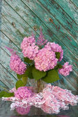 Still life bouquet with pink hydrangea and astilba on the old chair with homemade crochet tablecloth — Stock Photo