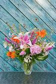 Still life bouquet: lily, hosta, astilbe, hemerocallis and pink hydrangea — Stock Photo