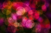 Abstractos círculos brillantes colores sobre un fondo colorido — Foto de Stock