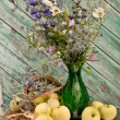 Stock Photo: Still life wild flowers bouquet in green vase with apples