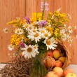 Still life of wild flowers and apples — Stock Photo