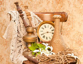 Time concept still life: antique clock, oil lamp and vase on the oid chair — Stock Photo