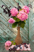 Pink hydrangea and violet basil bouquet in a vintage vase still life — Stock Photo