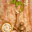 Time concept still life with antique clock old oil lamp and white hydrangea — Stock Photo