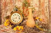Still life with clock, mushrooms and sea-buckethorn — Stock Photo