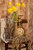 Still life with antique clock and yellow flowers — Stock Photo