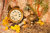 Time concept still life with mushrooms and sea-buckthorn — Stock Photo
