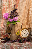 Still life with antique clock and pink hydrangea — Stock Photo