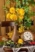 Still life with yellow flowers and clock — Stock Photo
