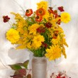 Yellow flowers still life bouquet with berries — Stock Photo