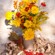 Yellow flowers still life bouquet with berries, rope and sawdust — Stock Photo