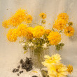 Wet still life of yellow flowers through wet glass — Stock Photo