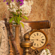 Still life with phlox bouquet in a vintage vase on the old chair with antique clock and oil lamp — Stock Photo