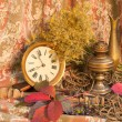 Autumnal still life with clock and oil lamp — Stock Photo