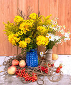 Two wild flowers bouquets with apples and berries — Stock Photo