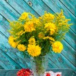 Yellow wild flowers bouquet with red berries still life — Stock Photo