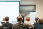 Mensen zitten op de business-conferentie — Stockfoto