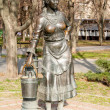 Sculpture of the girl with bucket near the pump as a Rostov water supply company symbol, opened at the 23th of August 2007 year, architect Sergey Oleshnya and Anatooly Dementiev — Stock Photo #36506307