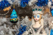 Toy queen and new year decorations in white and blue colors — Stock Photo