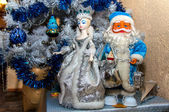 Toy santa claus and queen with the new year decorations in white and blue colors — Stock Photo