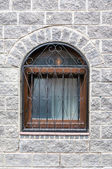 Old window in a stone wall — Stock Photo