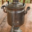 Samovar - traditional Russian utensil, on the wooden table — Stock Photo