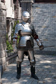 Knight in the ancient metal armor — Stock Photo