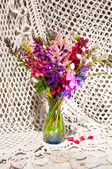 Still life bouquet with lupine and bright flowers — Stock Photo