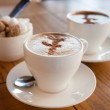 Cups of coffee and sugar — Stock Photo #50678817