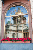 Window with reflection of St Isaac Cathedral, Russia, St Petersburg — Stock Photo